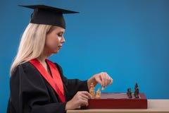 Muchacha del estudiante en fondo azul Fotografía de archivo libre de regalías