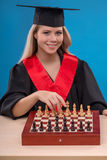 Muchacha del estudiante en fondo azul Foto de archivo libre de regalías