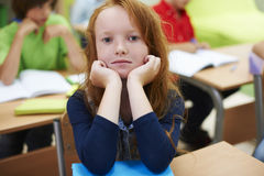 Muchacha del estudiante en la sala de clase Fotografía de archivo libre de regalías