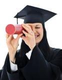 Muchacha del estudiante en un vestido académico, Imagen de archivo libre de regalías