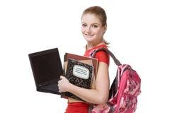 Muchacha del estudiante femenino de la universidad con la computadora portátil, morral Imagen de archivo
