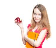 Muchacha del estudiante que come la manzana. Fotos de archivo