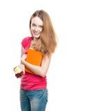 Muchacha del estudiante que come la manzana. Imagenes de archivo