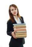 Muchacha del estudiante universitario que sostiene los libros Imágenes de archivo libres de regalías