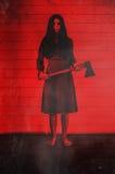 Muchacha del fantasma con el destral Fotos de archivo