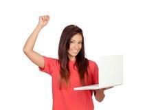 Muchacha del ganador con un ordenador portátil Imagen de archivo libre de regalías