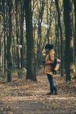 Muchacha del inconformista en un parque Imagen de archivo libre de regalías