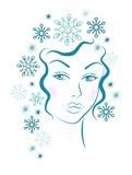 Muchacha del invierno con el pelo azul de los copos de nieve Foto de archivo libre de regalías