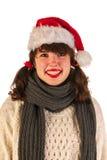 Muchacha del invierno con el sombrero Papá Noel Fotografía de archivo libre de regalías