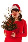 Muchacha del invierno con el sombrero Papá Noel Foto de archivo libre de regalías
