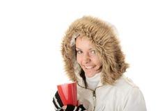 Muchacha del invierno con la taza caliente Foto de archivo libre de regalías