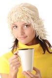 Muchacha del invierno con la taza caliente Fotos de archivo