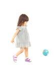 Muchacha del niño que juega con el globo del mundo Imágenes de archivo libres de regalías