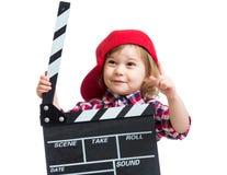 Muchacha del niño que lleva a cabo el tablero de chapaleta en manos Foto de archivo libre de regalías