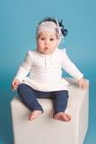 Muchacha del niño sobre azul Imagen de archivo