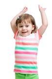 Muchacha del niño con las manos para arriba aisladas en blanco Fotografía de archivo libre de regalías