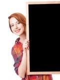 Muchacha del pelirrojo con la pizarra Imagen de archivo libre de regalías