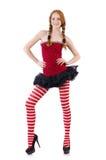 Muchacha del pelirrojo en vestido y medias rojos Fotos de archivo libres de regalías