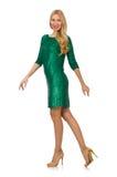 Muchacha del pelo rubio en el vestido verde chispeante aislado Imágenes de archivo libres de regalías