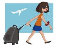 Muchacha del recorrido en el aeropuerto Imagen de archivo libre de regalías