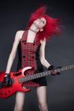 Muchacha del Redhead con la guitarra Fotos de archivo libres de regalías