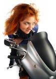 Muchacha del redhead de Moto Fotografía de archivo libre de regalías