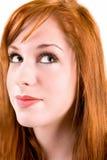Muchacha del Redhead que mira para arriba imagen de archivo libre de regalías