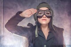 Muchacha del soldado en elevador retro Imagenes de archivo