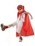 Muchacha del super héroe en un rojo Foto de archivo libre de regalías