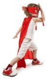 Muchacha del super héroe en un rojo foto de archivo