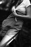 Muchacha del torso en camiseta rayada Imagenes de archivo