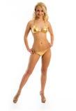 Muchacha delgada en bikini del oro imagen de archivo libre de regalías