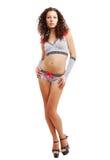 Muchacha delgada en ropa erótica del punto de polca con los arqueamientos Fotografía de archivo