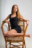 Muchacha delgada en silla de la vendimia Imagen de archivo libre de regalías