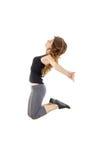 Muchacha deportiva que hace estirando ejercicios teena delgado del estilo del hip-hop Imágenes de archivo libres de regalías