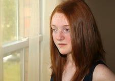 Muchacha deprimida del preadolescente del redhead Imagen de archivo