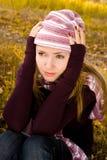 Muchacha deprimida en el parque Fotos de archivo