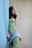 Muchacha detrás de la cortina Imagenes de archivo