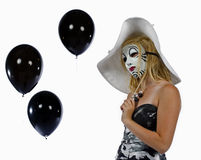 Muchacha detrás de la máscara Imagenes de archivo