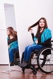 Muchacha discapacitada que mira el espejo Imágenes de archivo libres de regalías