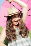 Muchacha divertida con el parasol Imagen de archivo