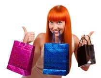 Muchacha divertida con un bolso del regalo Imagen de archivo libre de regalías