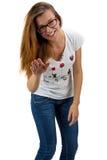 Muchacha divertida del adolescente con los vidrios Foto de archivo libre de regalías