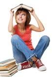Muchacha divertida del estudiante con los libros Foto de archivo libre de regalías