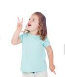 Muchacha divertida del niño que hace al ganador del símbolo fotos de archivo