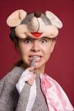 Muchacha divertida en un traje del ratón Fotos de archivo