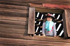 Muchacha dulce del país que juega el vestido-para arriba Foto de archivo libre de regalías