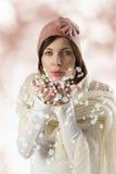 Muchacha dulce que sopla en escamas de la nieve Fotografía de archivo libre de regalías