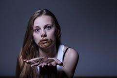 Muchacha durante ataque bulímico Foto de archivo libre de regalías