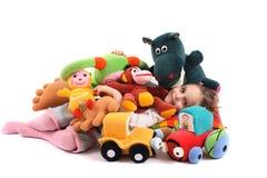 Muchacha durmiente con los juguetes Imágenes de archivo libres de regalías